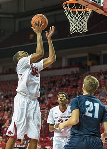 Arkansas Razorbacks forward Keaton Miles (55) shoots during a basketball game between the Arkansas Razorbacks and the Southwestern Oklahoma State Bulldogs in Bud Walton Arena on November 5, 2015.   Arkansas won 103-58.   (Alan Jamison, Nate Allen Sports Service)