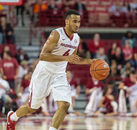 Arkansas Razorbacks guard Jabril Durham (4) takes the ball downcourt during a basketball game between the Arkansas Razorbacks and the Southwestern Oklahoma State Bulldogs in Bud Walton Arena on November 5, 2015.   Arkansas won 103-58.   (Alan Jamison, Nate Allen Sports Service)