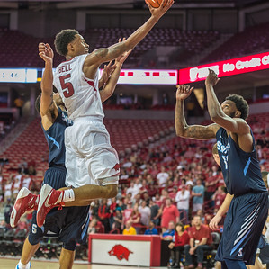 Arkansas Razorbacks guard Anthlon Bell (5) with a shot during a basketball game between the Arkansas Razorbacks and the Southwestern Oklahoma State Bulldogs in Bud Walton Arena on November 5, 2015.   Arkansas won 103-58.   (Alan Jamison, Nate Allen Sports Service)