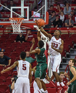 Moses Kingsley (33) with a block during a basketball game between Arkansas and Delta State on November 10, 2015.    (Alan Jamison, Nate Allen Sports Service)
