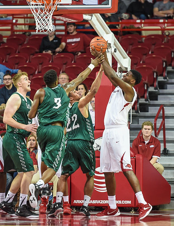 Trey Thompson (1) with a rebound during a basketball game between Arkansas and Delta State on November 10, 2015.    (Alan Jamison, Nate Allen Sports Service)