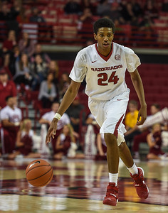 Jimmy Whitt (24) takes the ball downcourt during a basketball game between Arkansas and Delta State on November 10, 2015.    (Alan Jamison, Nate Allen Sports Service)