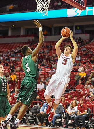 Dusty Hannahs (3) shoots during a basketball game between Arkansas and Delta State on November 10, 2015.    (Alan Jamison, Nate Allen Sports Service)