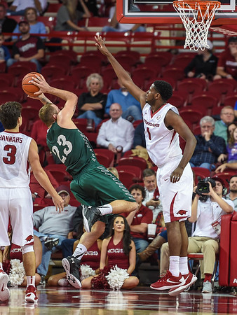 Trey Thompson (1) defends against Delta State guard Devin Schmidt (23) during a basketball game between Arkansas and Delta State on November 10, 2015.    (Alan Jamison, Nate Allen Sports Service)