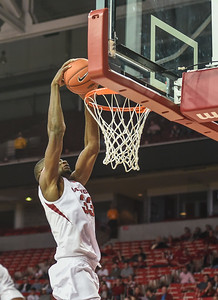 Moses Kingsley (33) with a dunk during a basketball game between Arkansas and Delta State on November 10, 2015.    (Alan Jamison, Nate Allen Sports Service)