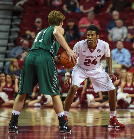 Jimmy Whitt (24) defends against Delta State guard Dakota Dailey (11) during a basketball game between Arkansas and Delta State on November 10, 2015.    (Alan Jamison, Nate Allen Sports Service)