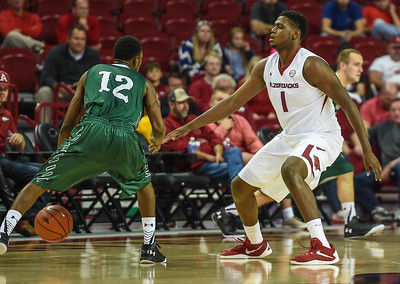 Trey Thompson (1) defends against Delta State guard Terry Morris (12)  during a basketball game between Arkansas and Delta State on November 10, 2015.    (Alan Jamison, Nate Allen Sports Service)