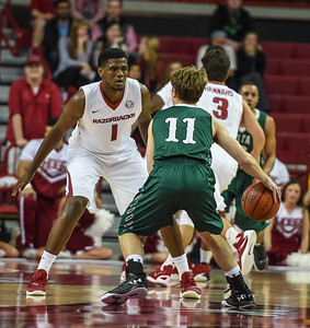 Trey Thompson (1) guards Delta State guard Dakota Dailey (11) during a basketball game between Arkansas and Delta State on November 10, 2015.    (Alan Jamison, Nate Allen Sports Service)