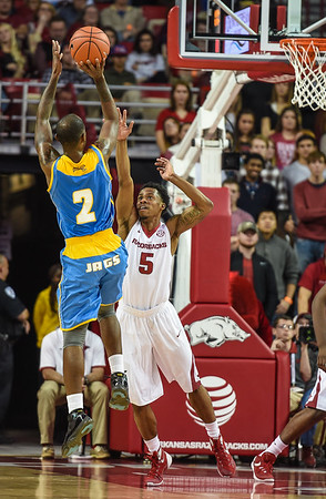 Arkansas Razorbacks guard Anthlon Bell (5) defends during a basketball game between Arkansas and Southern University on November 13, 2015.    (Alan Jamison, Nate Allen Sports Service)
