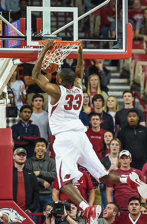 Arkansas Razorbacks forward Moses Kingsley (33) with a dunk during a basketball game between Arkansas and Southern University on November 13, 2015.    (Alan Jamison, Nate Allen Sports Service)