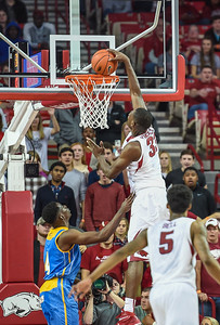 Arkansas Razorbacks forward Moses Kingsley (33) with a one handed slam during a basketball game between Arkansas and Southern University on November 13, 2015.    (Alan Jamison, Nate Allen Sports Service)