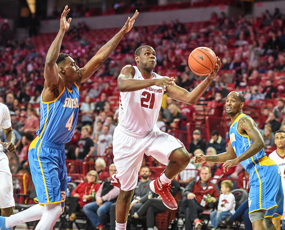 Arkansas Razorbacks guard Manuale Watkins (21) drives during a basketball game between Arkansas and Southern University on November 13, 2015.    (Alan Jamison, Nate Allen Sports Service)