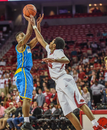 Arkansas Razorbacks guard Jimmy Whitt (24) defends and fouls during a basketball game between Arkansas and Southern University on November 13, 2015.    (Alan Jamison, Nate Allen Sports Service)