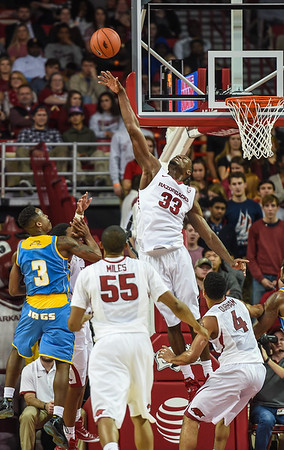 Arkansas Razorbacks forward Moses Kingsley (33) with a block during a basketball game between Arkansas and Southern University on November 13, 2015.    (Alan Jamison, Nate Allen Sports Service)