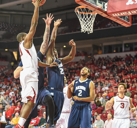 Arkansas Razorbacks guard Manuale Watkins (21) shoots during a basketball game between Arkansas and Akron on November 18, 2015.    (Alan Jamison, Nate Allen Sports Service)