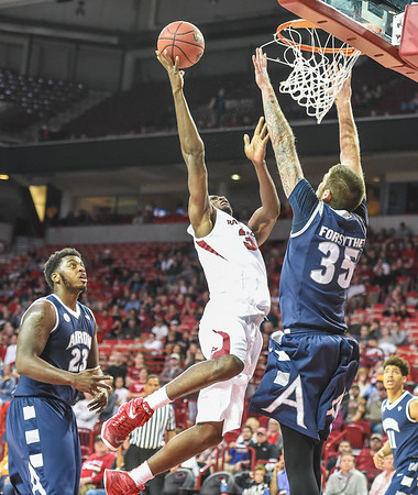 Arkansas Razorbacks forward Moses Kingsley (33) shoots during a basketball game between Arkansas and Akron on November 18, 2015.    (Alan Jamison, Nate Allen Sports Service)