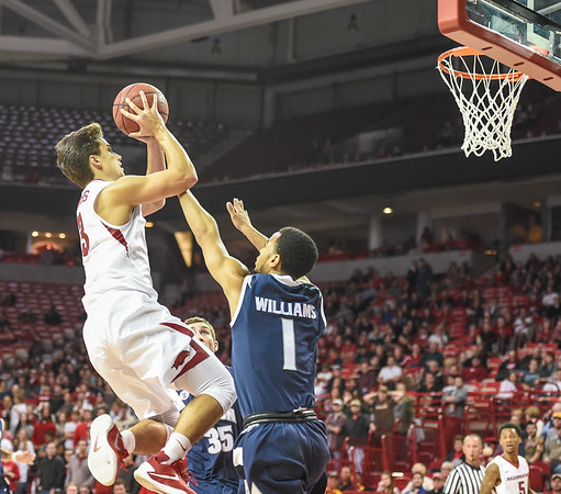 Arkansas Razorbacks guard Dusty Hannahs (3) shoots while being guarded by Akron Zips guard Josh Williams (1) during a basketball game between Arkansas and Akron on November 18, 2015.    (Alan Jamison, Nate Allen Sports Service)
