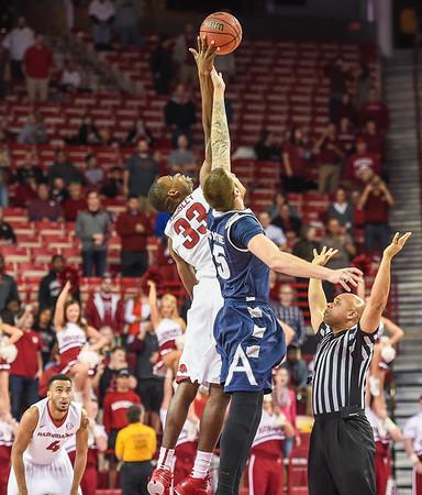 Arkansas Razorbacks forward Moses Kingsley (33) controls the opening jump during a basketball game between Arkansas and Akron on November 18, 2015.    (Alan Jamison, Nate Allen Sports Service)