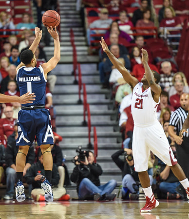 Akron Zips guard Josh Williams (1) shoots during a basketball game between Arkansas and Akron on November 18, 2015.    (Alan Jamison, Nate Allen Sports Service)