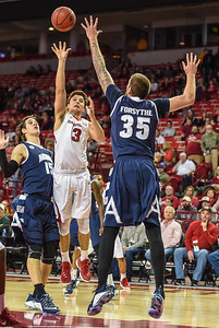 Arkansas Razorbacks guard Dusty Hannahs (3) shoots with Akron Zips center Pat Forsythe (35) defending during a basketball game between Arkansas and Akron on November 18, 2015.    (Alan Jamison, Nate Allen Sports Service)
