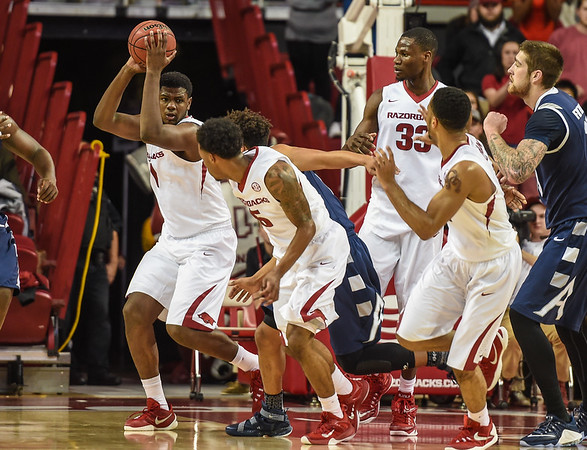 Arkansas Razorbacks forward Trey Thompson (1) clears a rebound during a basketball game between Arkansas and Akron on November 18, 2015.    (Alan Jamison, Nate Allen Sports Service)