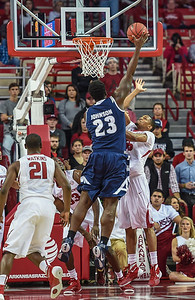 Akron Zips center Isaiah Johnson (23) shoots during a basketball game between Arkansas and Akron on November 18, 2015.    (Alan Jamison, Nate Allen Sports Service)