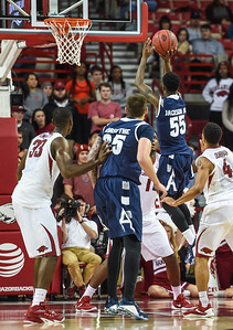 Akron Zips guard Antino Jackson (55) shoots during a basketball game between Arkansas and Akron on November 18, 2015.    (Alan Jamison, Nate Allen Sports Service)