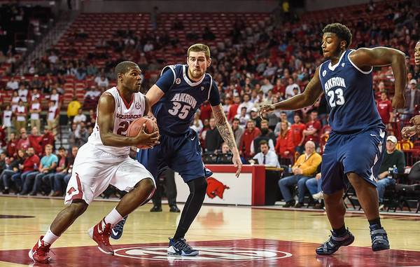 Arkansas Razorbacks guard Manuale Watkins (21) drives during a basketball game between Arkansas and Akron on November 18, 2015.    (Alan Jamison, Nate Allen Sports Service)