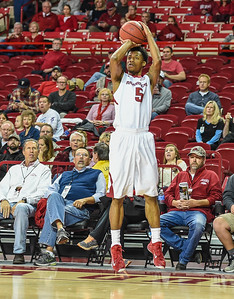 Arkansas Razorbacks guard Anthlon Bell (5) shoots during a basketball game between Arkansas and Akron on November 18, 2015.    (Alan Jamison, Nate Allen Sports Service)