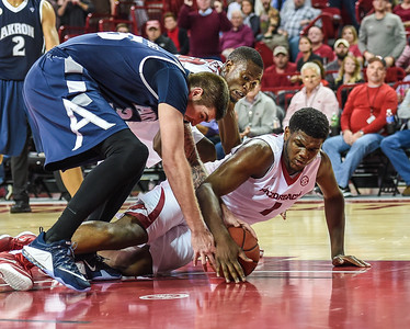 Arkansas Razorbacks forward Trey Thompson (1) on the floor fighting for the ball during a basketball game between Arkansas and Akron on November 18, 2015.    (Alan Jamison, Nate Allen Sports Service)