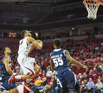 Arkansas Razorbacks guard Jabril Durham (4) shoots during a basketball game between Arkansas and Akron on November 18, 2015.    (Alan Jamison, Nate Allen Sports Service)