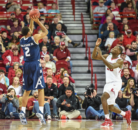 Akron Zips forward Kwan Cheatham Jr. (2) shoots during a basketball game between Arkansas and Akron on November 18, 2015.    (Alan Jamison, Nate Allen Sports Service)