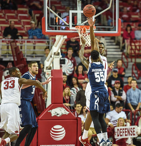 Arkansas Razorbacks forward Trey Thompson (1) defends a shot by Akron Zips guard Antino Jackson (55) during a basketball game between Arkansas and Akron on November 18, 2015.    (Alan Jamison, Nate Allen Sports Service)