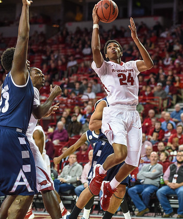 Arkansas Razorbacks guard Jimmy Whitt (24) shoots during a basketball game between Arkansas and Akron on November 18, 2015.    (Alan Jamison, Nate Allen Sports Service)
