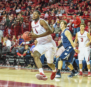 Arkansas Razorbacks forward Trey Thompson (1) drives in for a dunk during a basketball game between Arkansas and Akron on November 18, 2015.    (Alan Jamison, Nate Allen Sports Service)