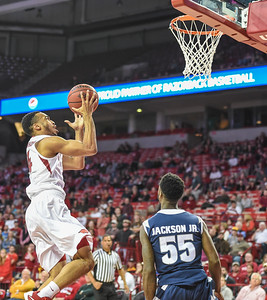 Arkansas Razorbacks guard Jabril Durham (4) with a layup during a basketball game between Arkansas and Akron on November 18, 2015.    (Alan Jamison, Nate Allen Sports Service)