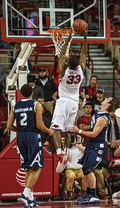 Arkansas Razorbacks forward Moses Kingsley (33) with a dunk during a basketball game between Arkansas and Akron on November 18, 2015.    (Alan Jamison, Nate Allen Sports Service)
