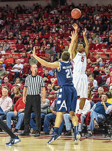 Arkansas Razorbacks guard Anthlon Bell (5) shoots while being defended by Akron Zips forward Reggie McAdams (21) during a basketball game between Arkansas and Akron on November 18, 2015.    (Alan Jamison, Nate Allen Sports Service)