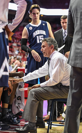Akron head coach Keith Dambrot calls plays during a timeout during a basketball game between Arkansas and Akron on November 18, 2015.    (Alan Jamison, Nate Allen Sports Service)