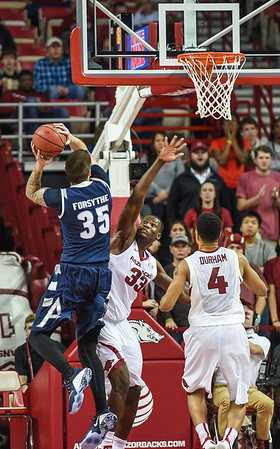 Akron Zips center Pat Forsythe shoots during a basketball game between Arkansas and Akron on November 18, 2015.    (Alan Jamison, Nate Allen Sports Service)