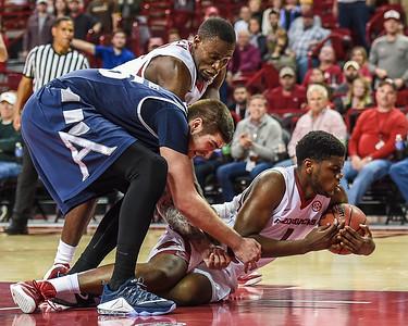 Arkansas Razorbacks forward Trey Thompson (1) on the floor fighting for the ball during a basketball game between Arkansas and Akron on November 18, 2015.    (Alan Jamison, Nate Allen Sports Service)