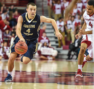 Charleston Southern Buccaneers guard Patrick Wallace (4) drives during a basketball game between Arkansas and Charleston Southern on November 20, 2015.    (Alan Jamison, Nate Allen Sports Service)