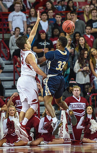 Arkansas Razorbacks guard Dusty Hannahs (3) defends against Charleston Southern Raymond Robinson (33) during a basketball game between Arkansas and Charleston Southern on November 20, 2015.    (Alan Jamison, Nate Allen Sports Service)