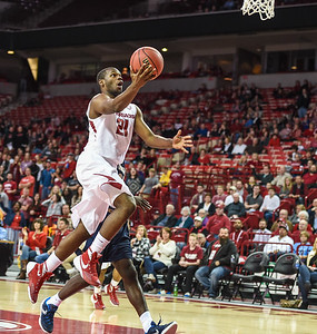Arkansas Razorbacks guard Manuale Watkins (21) with a layup during a basketball game between Arkansas and Charleston Southern on November 20, 2015.    (Alan Jamison, Nate Allen Sports Service)