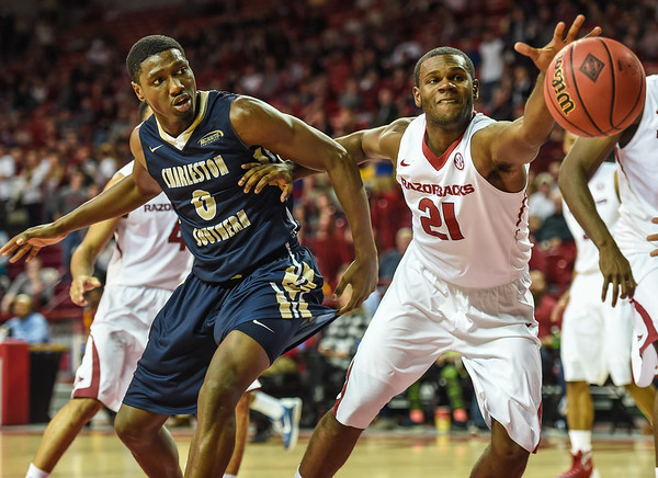 Arkansas Razorbacks guard Manuale Watkins (21) fights for the ball during a basketball game between Arkansas and Charleston Southern on November 20, 2015.    (Alan Jamison, Nate Allen Sports Service)