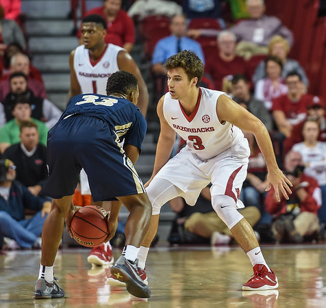 Arkansas Razorbacks guard Dusty Hannahs (3) defends during a basketball game between Arkansas and Charleston Southern on November 20, 2015.    (Alan Jamison, Nate Allen Sports Service)