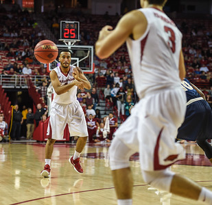 Arkansas Razorbacks guard Jabril Durham (4) passes to Arkansas Razorbacks guard Dusty Hannahs (3) during a basketball game between Arkansas and Charleston Southern on November 20, 2015.    (Alan Jamison, Nate Allen Sports Service)