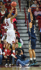 Arkansas Razorbacks guard Anthlon Bell (5) shoots during a basketball game between Arkansas and Charleston Southern on November 20, 2015.    (Alan Jamison, Nate Allen Sports Service)