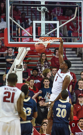 Arkansas Razorbacks forward Trey Thompson (1) with a stuff during a basketball game between Arkansas and Charleston Southern on November 20, 2015.    (Alan Jamison, Nate Allen Sports Service)