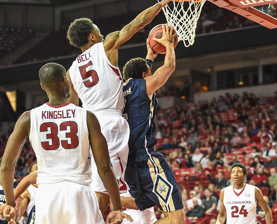 Arkansas Razorbacks guard Anthlon Bell (5) defends during a basketball game between Arkansas and Charleston Southern on November 20, 2015.    (Alan Jamison, Nate Allen Sports Service)